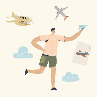 Garoto feliz correndo com o avião de papel na mão.