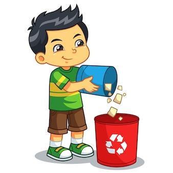 Garoto jogando lixo no lixo.