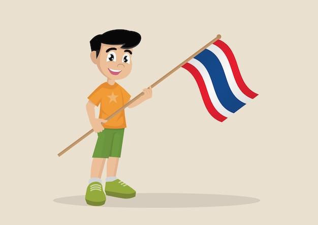 Garoto segurando uma bandeira da tailândia.