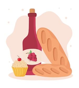 Garrafa de vinho e pães