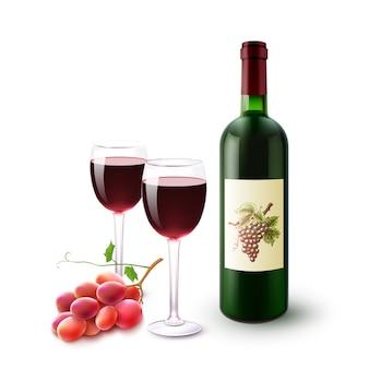 Garrafa de vinho tinto, vidros e uvas