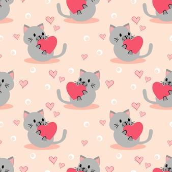 Gatinho bonitinho e coração rosa sem costura padrão.
