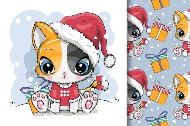 Gatinho bonito dos desenhos animados em um boné de malha senta-se na neve