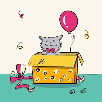 Gatinho desenhado de mão em uma caixa como presente de aniversário