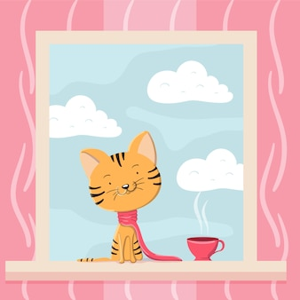 Gatinho fofo em um lenço e uma xícara de chá está sentado no peitoril da janela