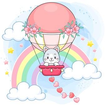 Gatinho fofo pastel em um balão de ar quente rosa em um mundo de arco-íris