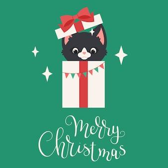 Gatinho preto espiando fora da caixa de presente de natal