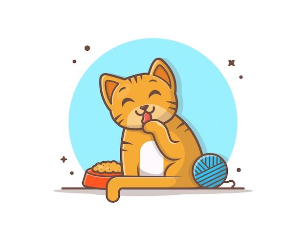 Gato bonito com comida e bola de fios