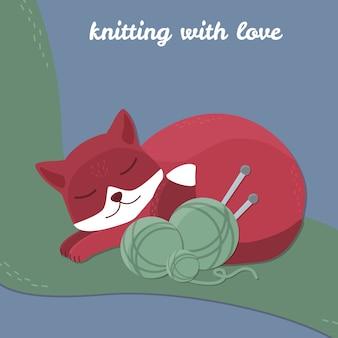Gato bonito com fio de lã e agulha de tricô.