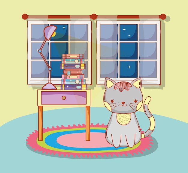Gato bonito com lâmpada e livros na mesa