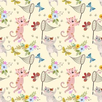 Gato bonito e borboleta dos desenhos animados no teste padrão de jardim de flores.