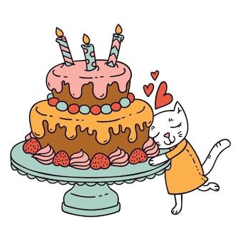 Gato com bolo de aniversário.