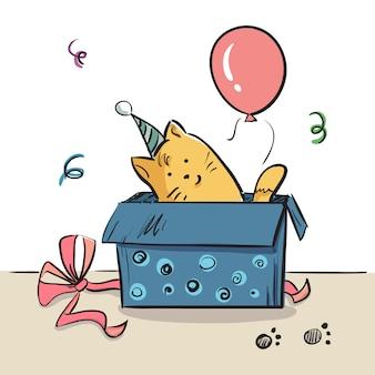 Gato em uma caixa. cartão de aniversário