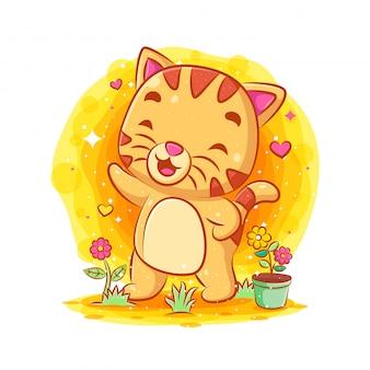 Gato engraçado em pé e cantando no jardim