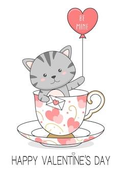 Gato fofo em um copo segurando uma carta de amor e um balão
