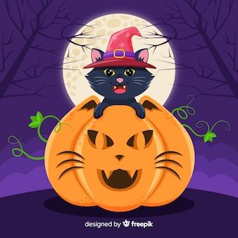 Gato preto de halloween em abóbora com lua cheia