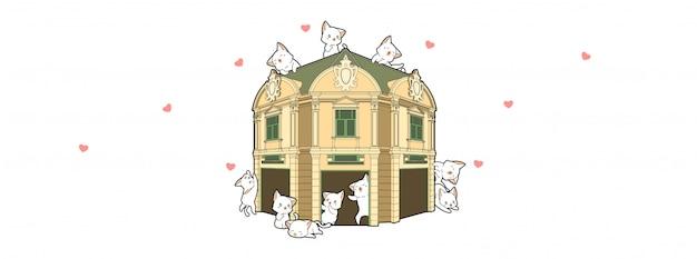 Gatos adoráveis com edifício histórico