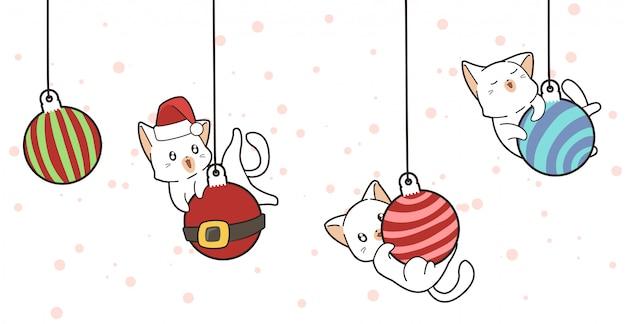Gatos adoráveis e bolas de natal