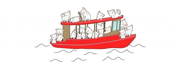 Gatos adoráveis estão viajando com barco vermelho