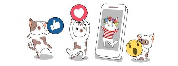 Gatos bonitos estão dando ícone de mídia social para o outro gato que está no smartphone
