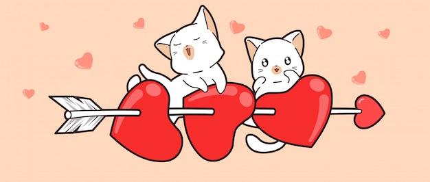 Gatos brancos em corações perfurados com uma flecha