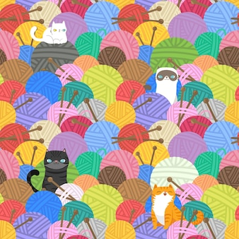 Gatos em bolas de fio e padrão sem emenda de agulha de tricô