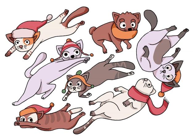 Gatos flutuantes de natal usando cachecol e chapéu de papai noel