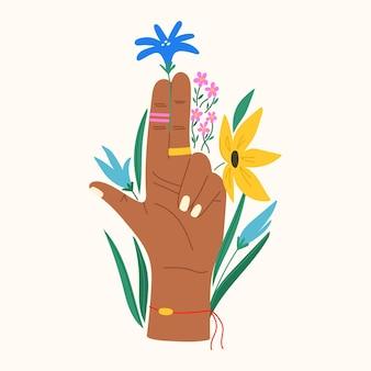 Gesto com flores e folhas composição plana da moda com a mão segurando uma flor