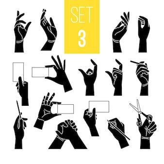 Gestos de mãos com cartão e caneta. silhuetas de mãos negras segurando um tablet de papel e uma tesoura, um cigarro e um ponteiro isolado no branco