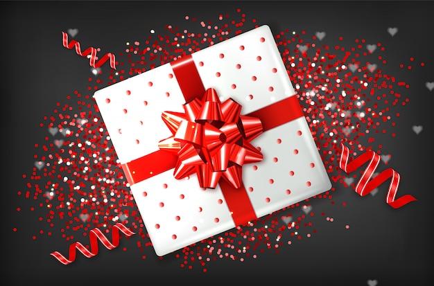 Giftbox com laço vermelho Vetor Premium