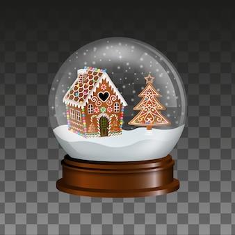Globo de neve de natal com casa de pão de mel e árvore
