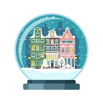 Globo de neve de natal com casas de amesterdão