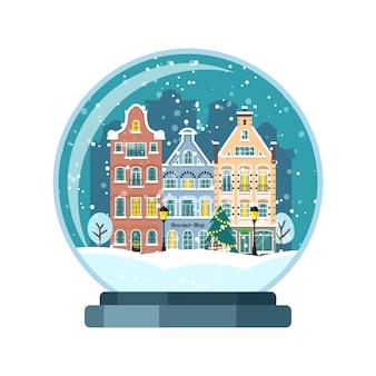 Globo de neve de natal com casas de amsterdã
