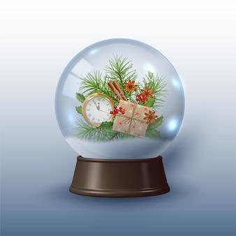 Globo de neve ou bola de natal com um relógio e enfeites