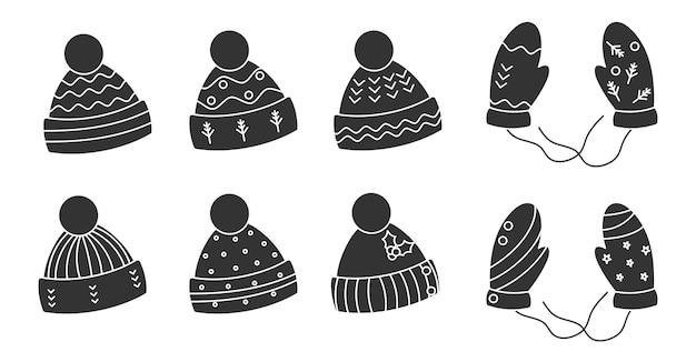 Glyph chapéus pretos de malha, conjunto de luvas. boné de inverno aconchegante com pom-pom. roupas quentes de natal sazonais