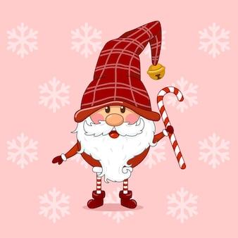 Gnomo de natal fofo segurando um bastão de doces