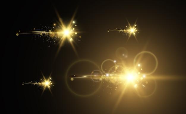 Gold sparkles, mágico, efeito de luz brilhante em um fundo transparente. póde ouro.