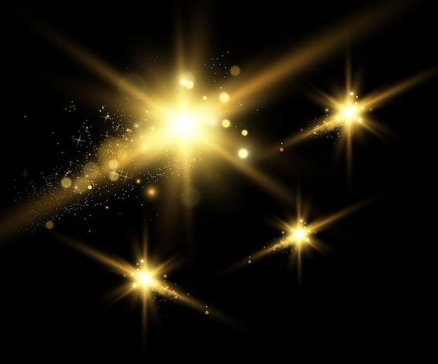 Gold sparkles, mágico, efeito de luz brilhante em um fundo transparente.