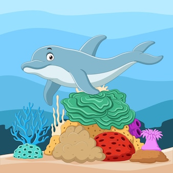 Golfinho de desenho animado com corais no mundo subaquático