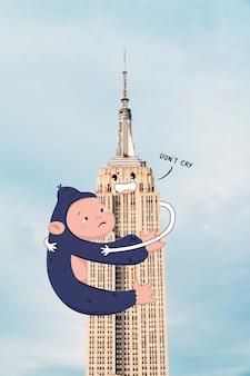 Gorila triste segurando o edifício do estado do império