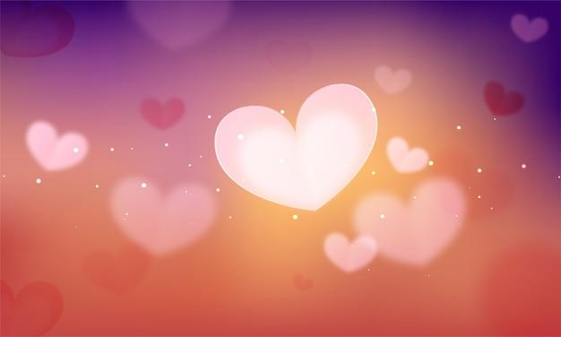 Gradiente de desfoque abstrato decorado com corações.