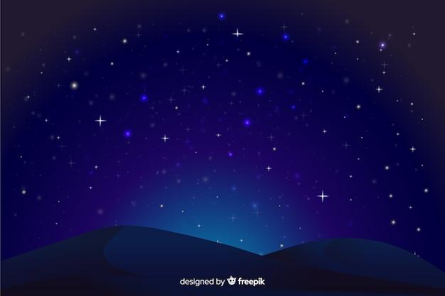 Gradiente de fundo de noite estrelada e formas de montanha