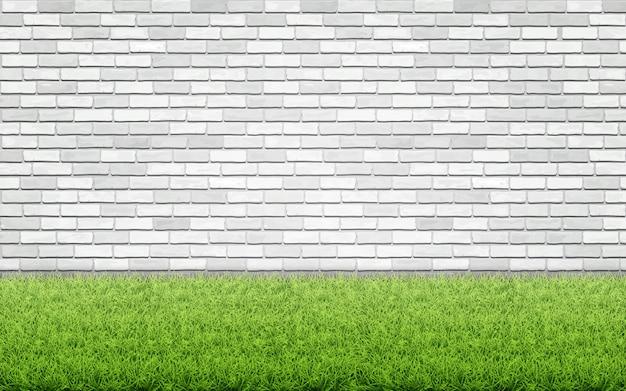 Gramado de grama e parede de tijolo branco.