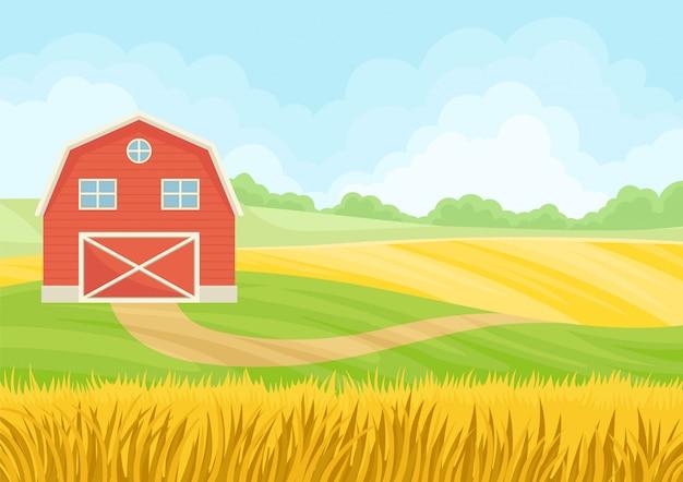 Grande celeiro vermelho com portão fechado em um campo de trigo.