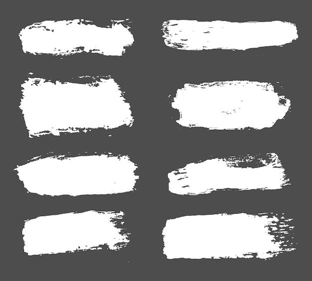 Grande coleção de tinta branca, pinceladas de tinta, pincéis, linhas, grungy.