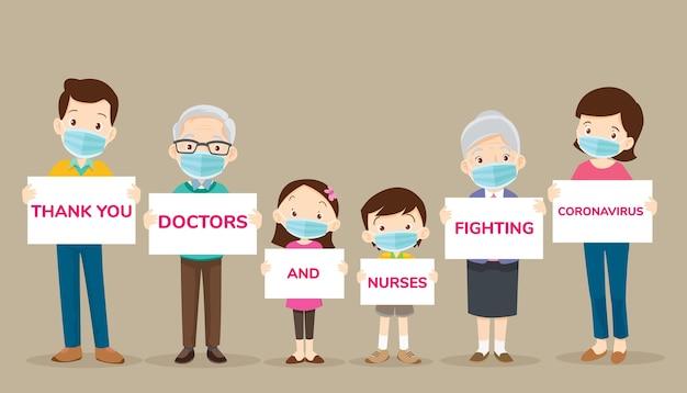 Grande família segurando cartazes para obrigado, médicos e enfermeiras