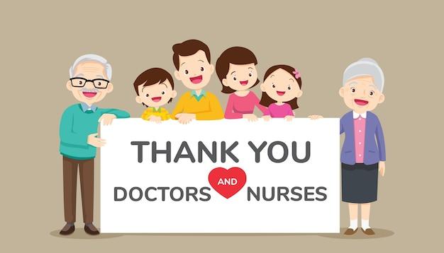 Grande família segurando cartazes vazios para obrigado, médicos e enfermeiras
