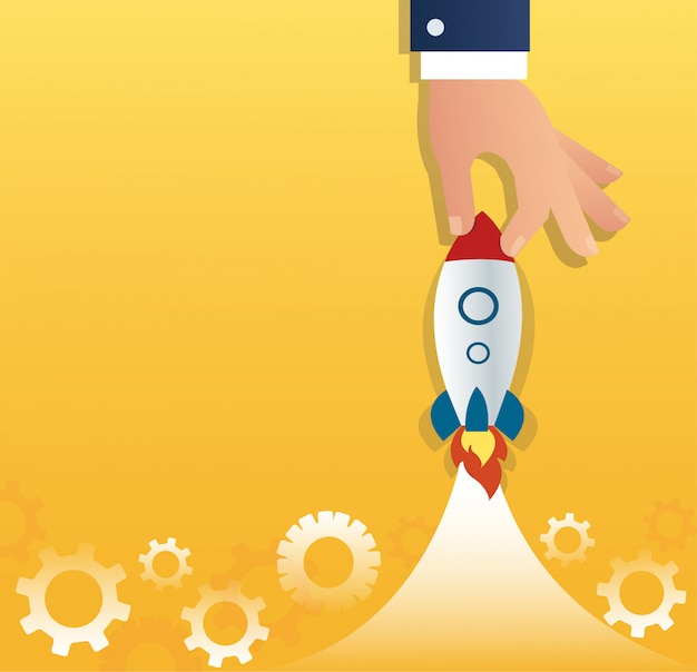 Grande mão segurando um negócio de inicialização do foguete