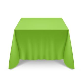 Grande mesa de banquete vazia coberta com toalha de mesa verde