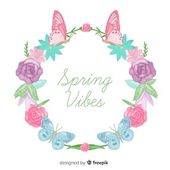 Grinalda de borboletas e flores em aquarela